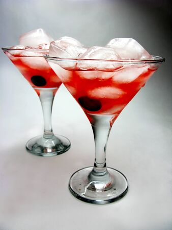 cruchon: alcoholic cruchon cocktails with ice and cherry