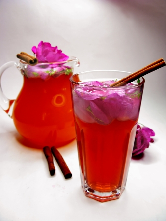 rose punch tea cocktail punch in jug and cup  photo