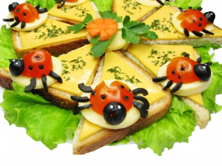 creative sandwich with cheese and lady bugs made of tomato photo