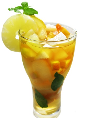 fruit cruchon cocktail punch in bowl with ice and fruit Stock Photo