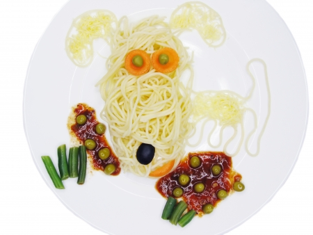 creative spaghetti food garnish with sausage dog shape photo