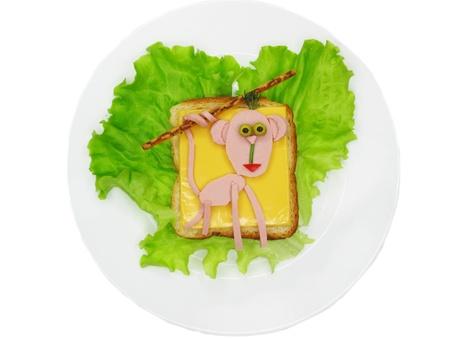 salame: creative sandwich with cheese and salame monkey shape