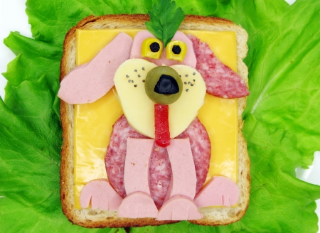 creative sandwich with cheese and salame dog shape Stock Photo