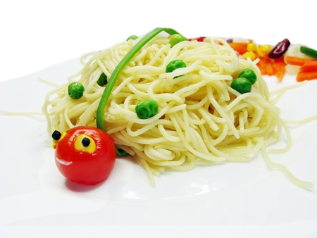 creative spaghetti food garnish with sausage ladybug shape photo