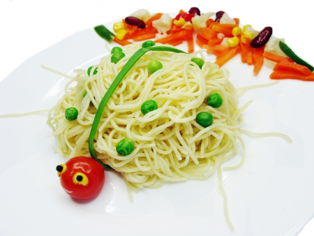 creative spaghetti food garnish with sausage lady-bug shape photo