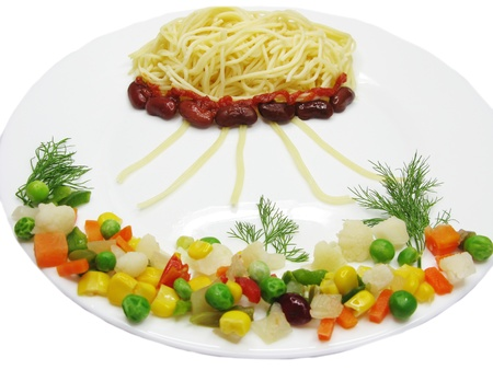 creative spaghetti food garnish with sausage sea world shape photo