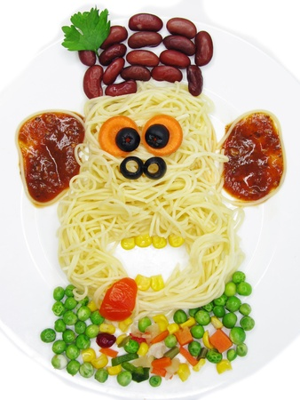 creative spaghetti food garnish with sausage monkey shape photo