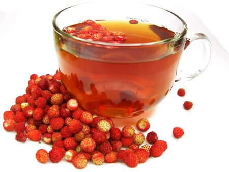 wild strawberry: fruit tea drink with ripe fresh wild strawberry berries