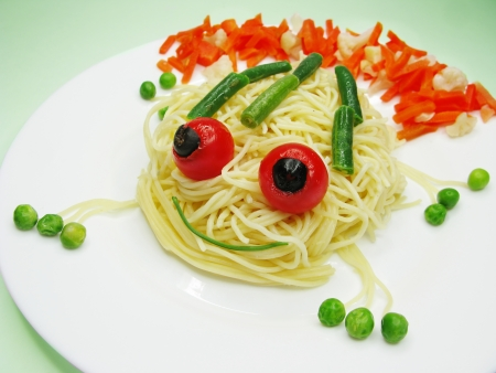 creative spaghetti food garnish with sausage frog shape photo