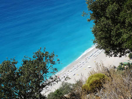 aegean sea landscape view of beach and mountains photo