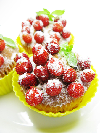 wild strawberry: fruit muffin cakes with wild strawberry berries