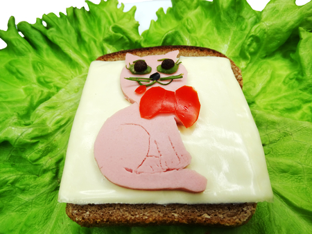 salame: creative sandwich with cheese and salame cat and dog shape