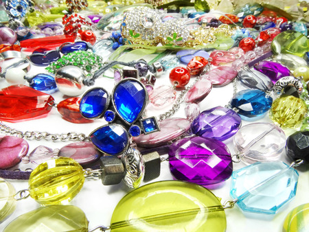 bright crystals beads and rings  fashion background photo