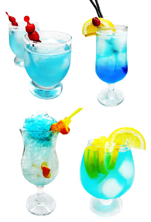 alcoholic blue lagoon cocktails with ice and cherry photo