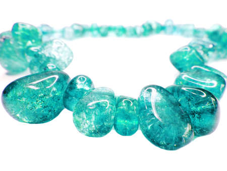 aquamarine gemstone beads isolated on white background photo