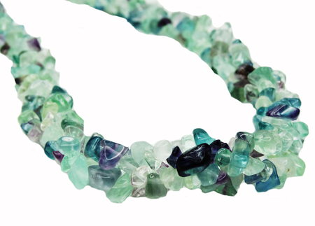 fluorite gemstone beads isolated on white background photo