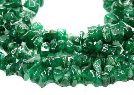 green tourmaline: avanturine gemstone beads isolated on white background