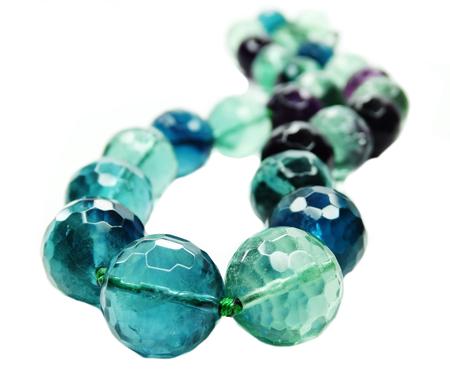fluorite: fluorite gemstone beads isolated on white background