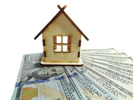 cash money: house model on dollar cash money background real estate concept Foto de archivo
