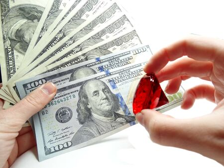 cash money: ruby gem on dollar cash money background real estate concept Foto de archivo