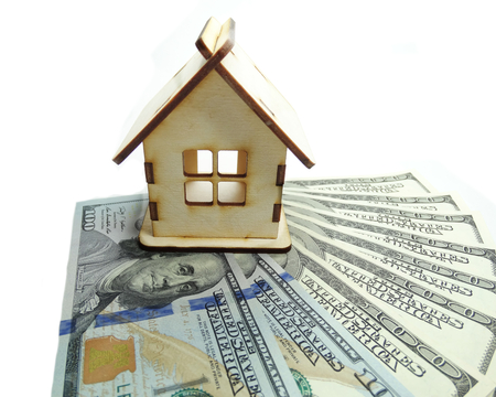 future earnings: house model on dollar cash money background real estate concept Stock Photo