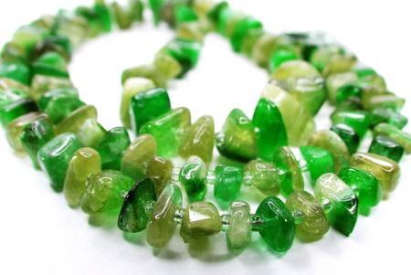 green tourmaline: emerald gemstone beads isolated on white background Stock Photo