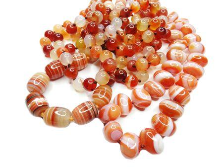 carnelian: carnelian gemstone beads isolated on white background