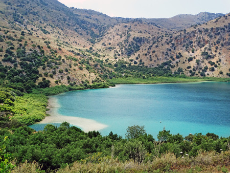 sunbeds relaxation near mountain lake Kournas Greece Stock Photo