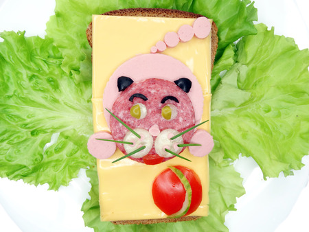 creative sandwich with cheese and sausage cat form