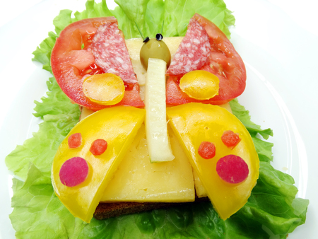 creative sandwich with cheese and sausage butterfly form Stock Photo