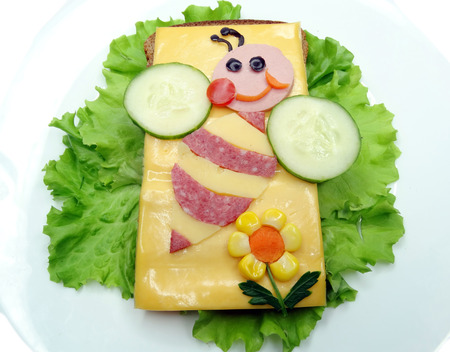 creative sandwich with cheese and sausage bee form Stock Photo