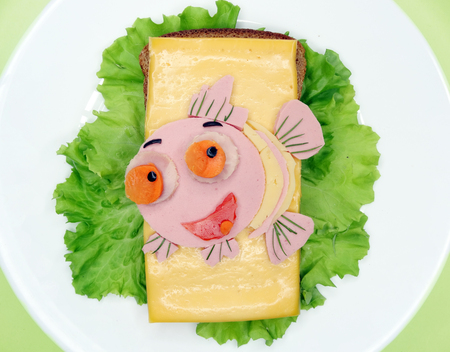 creative sandwich with cheese and sausage fish form