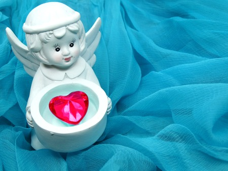 crystal heart: gem crystal heart in angels hands on silky cloth love concept