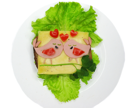 creative sandwich snack with sausage and cheese for child birds form
