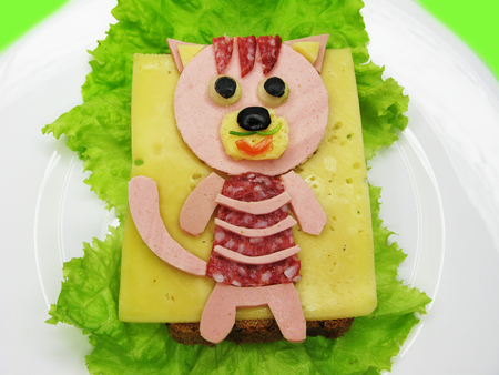 creative sandwich snack with sausage and cheese for child cat form