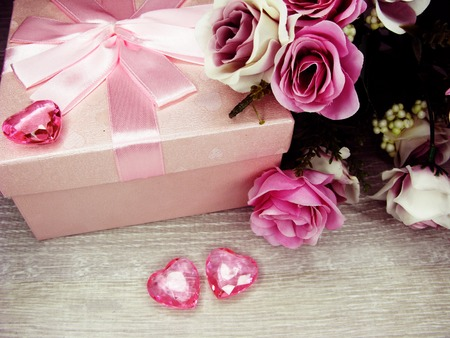 love valentines day gift box with hearts and rose flowers background  Stock Photo