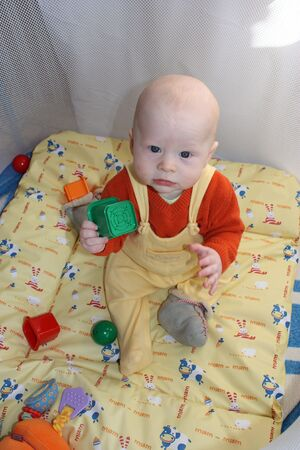 designer baby: The baby plays