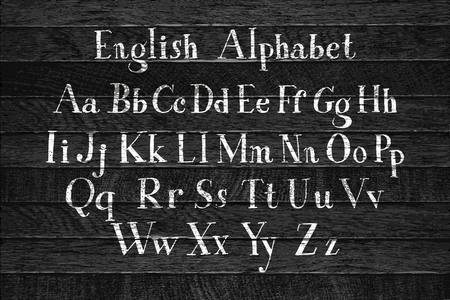 Vector calligraphic alphabet. Set of beautiful hand written letters. Classic english abc. Latin characters are on the wooden background. Vector illustration Çizim