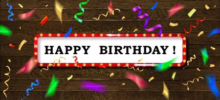 Gold lettering Happy Birthday with color golden streamers and confetti on dark background. On vintage wooden background.