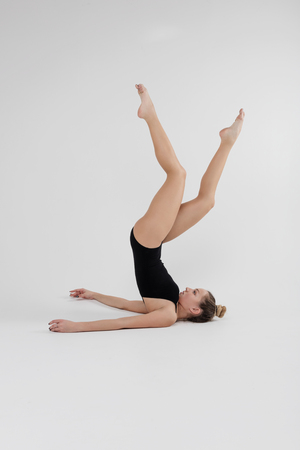 Beautiful young woman limber exerciser in the studio Stock fotó