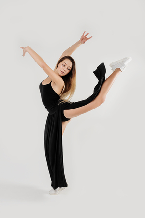 Beautiful young woman limber exerciser in the studio. Modern dancer