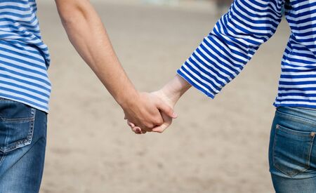 man and woman, hand in hand photo