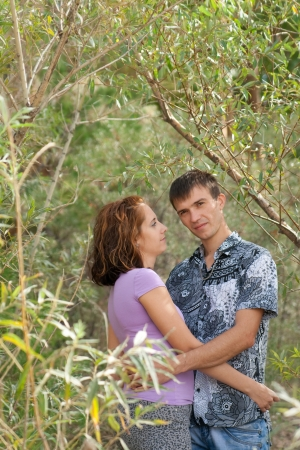 loving young couple is embracing in leaves