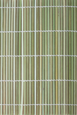 Macro fragment of bamboo mat for making sushi photo