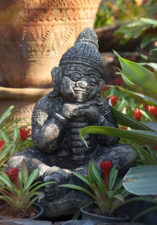imagery: ceramics sculpture of speeping idol in the botanic garden. Thailand. Nongnuch garden