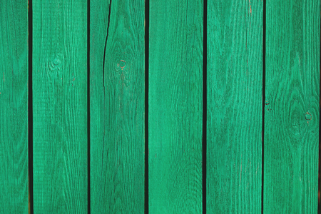 fragment of old wooden green fence