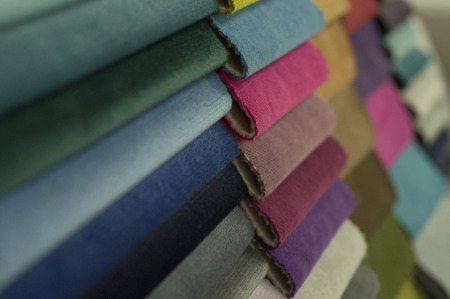 Catalogue of multicoloured cloth from matting fabric texture background.