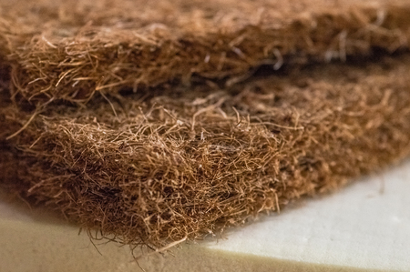 Mattress filler. Coconut coir, Nature para latex rubber, memory foam independent spring. Grated coconut shell for the production of mattresses. Background of Mattress filler.