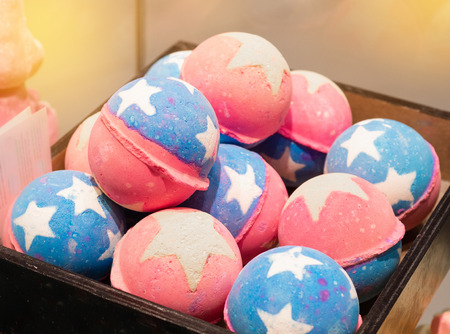 Shop cosmetic handmade bombs and bubble bath different colors. The concept of Spa and relaxation