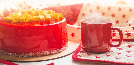 Birthday cake with one candle and red frosting. National bakery. Round cake with mango.